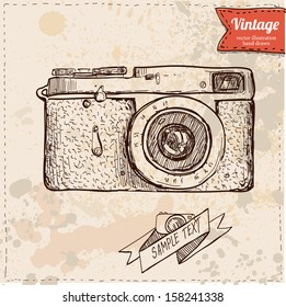 Vector illustration of camera hand draw on vintage paper background, cute label