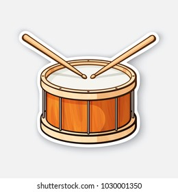 Vector illustration. Classic wooden drum with drumsticks. Percussion musical instrument. Rock or jazz equipment. Sticker with contour. Isolated on white background