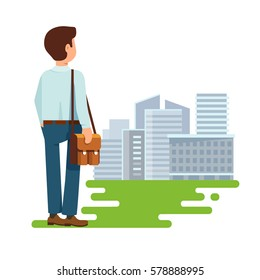 Vector illustration concept of search of work flat style. The young man, a student stands with his back to us and looking for a job  modern building city background