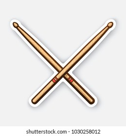 Vector illustration. Crossed wooden drumsticks. Percussion musical instrument. Rock or jazz equipment. Sticker with contour. Isolated on white background