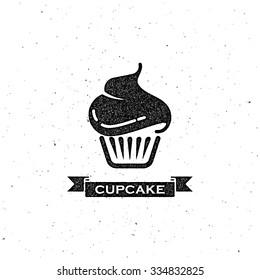 vector illustration with cupcake and vintage ribbon. letterpress label design