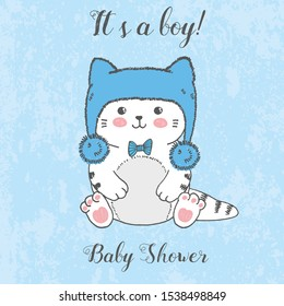 Vector illustration of cute hand drawn white kitten with winter fluffy blue hat, bow, cartoon card with handwritten lettering it's a boy, baby shower, drawing isolated on grunge scratched background