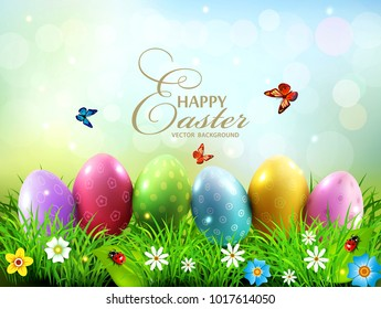 Vector illustration. Easter greeting card with colorful eggs lying on the green grass . Design element, greeting card template