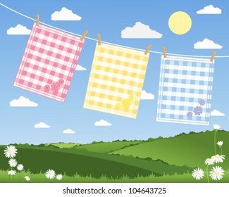 a vector illustration in eps 10 format of a washing line with three colorful gingham tea towels in a summer patchwork fields landscape under a blue sky