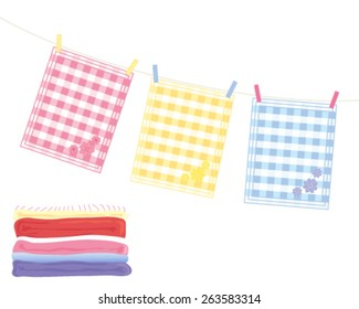 a vector illustration in eps 10 format of a washing line with colorful tea towels and a stack of fresh laundry on a white background
