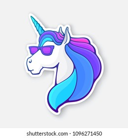 Vector illustration. Fairy tale unicorn head in sunglasses with a rainbow mane. Magic horse with horn and glasses. Imaginary mythical character. Sticker with contour. Isolated on white background