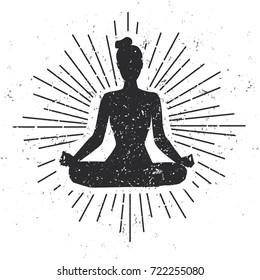 Vector illustration with female silhouette in meditating pose with scroll and sunburst on white background with grunge texture. Yoga concept print, poster, card and flyer design.