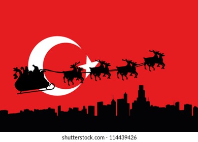 Vector Illustration of the flag of Turkey with santa flying his sliegh over a city