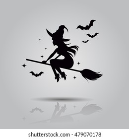 Vector illustration of flying young witch icon.  Witch silhuette on a broomstick