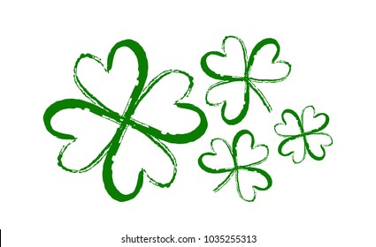 Vector illustration: Hand drawn brush shamrocks on white background. Sketch line clover.