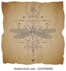 Vector illustration with hand drawn dragonfly and Sacred geometric symbol on vintage paper background with torn edges. Abstract mystic sign. Sepia linear shape. For you design.