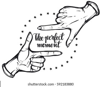 Vector illustration. Hand gesture,lettering the perfect moment. Handmade, prints on T-shirts, tattoos, background white,hand in the tattoo