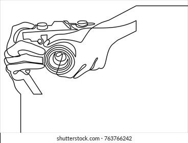 Vector Illustration of Hand Holding a Digital Camera- continuous line drawing