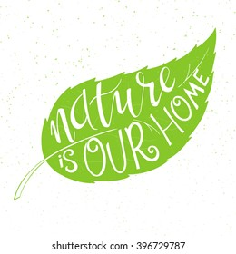 vector illustration of hand lettering text - nature is our home. This text is in green leaf. Can be used as the Earth day illustration element.