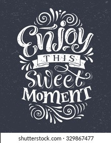 "Vector illustration with hand-drawn lettering on texture background. ""Enjoy this sweet moment"" inscription for invitation and greeting card, prints and posters. Calligraphic chalk design"