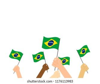 Vector illustration hands holding Brazil flags on white background
