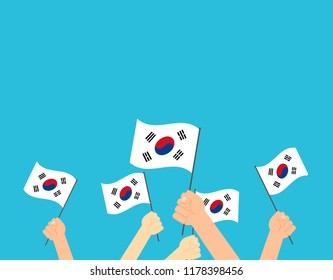 Vector illustration hands holding South Korea flags - South Korea Independence day greeting card