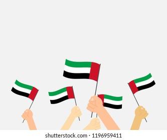 Vector illustration hands holding United Arab Emirates flags on white background
