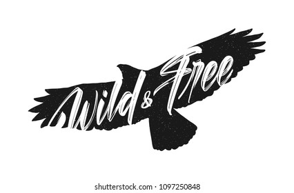 Vector illustration: Handwritten brush lettering of Wild and Free on silhouette of flying hawk background.