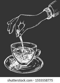 Vector illustration of healthy fresh drink. Delicate female hand stirring green or herbal tea with mint in cup. Vintage hand drawn style. White drawing on black