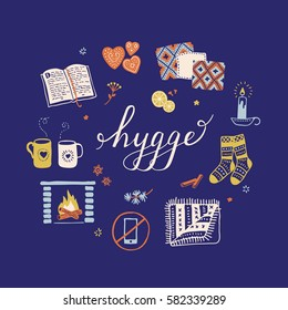 Vector illustration with Hygge lettering and cozy home things like candles, socks, oversize rug, tea, fireplace. Danish living concept. Greeting card template, hand drawn style.