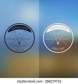 Vector illustration. Logos set paragliding club. Blurred background.