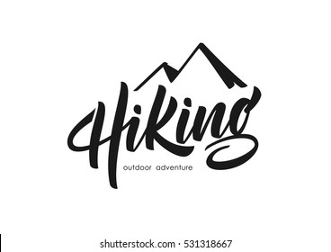 Vector illustration: Modern brush lettering of Hiking with silhouette of mountain.