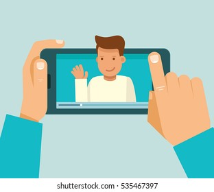 Vector illustration in modern flat style - video blogger concept - hand holding mobile phone with video player on the screen - male vlogger broadcasting on his personal channel