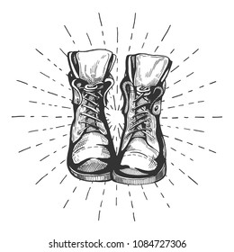 Vector illustration of an old leather laced travelling hiking boots with the sunburst. Vintage hand drawn style.