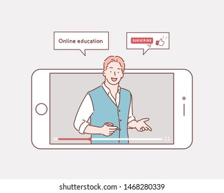 Vector illustration of online education. Concept of video blogging. The guy is in his video blog on the phone screen.  Hand drawn style vector design illustrations.