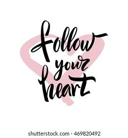 "Vector illustration. Poster. Card. Lettering. Calligraphy. The phrase ""Follow your heart."" The inscription is made brush marker."