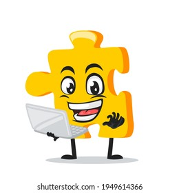 vector illustration of puzzle mascot or character presentation with laptop