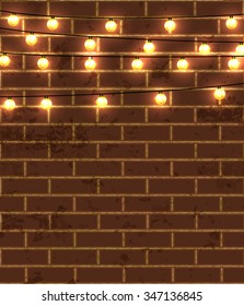 Vector illustration of red brick wall background with lighting garland festive decoration, with strings of round lamps.