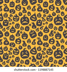 Vector illustration: seamless pattern: black scary carved pumpking icons on yellow background. Decorative element for Halloween party greeting cards, wallpapers, fabrics, wrapping paper, scrapbooking