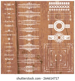 Vector illustration of a set of calligraphic dividers and floral page elements, corners and frames for scrapbook and other designs on wood background
