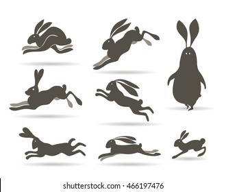 vector illustration. set of different poses and silhouettes of rabbits or hares. isolated on white background. graphic design element for titling