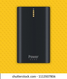 Vector illustration shows realistic black powerbank lies on a yellow background. Four orange little lamps indicate about full charge.