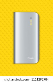 Vector illustration shows realistic powerbank lies on a yellow background. Four orange little lamps indicate about full charge.