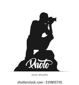 Vector illustration: Silhouette of photographer sitting on stone isolated on white background