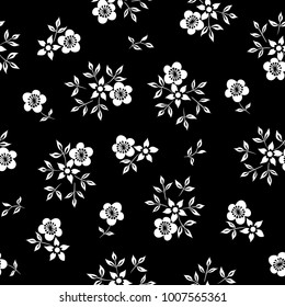 Vector illustration of simple white flowers on black background seamless pattern. Hand drawn.