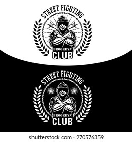 Vector illustration street fighting club emblem with fighter, chain and wreath.