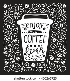 Vector illustration Take away coffee cup with lettering in black and white. Doodle mug with hand written inscription Enjoy your coffee break. Script on isolated silhouette  on background with swirls.