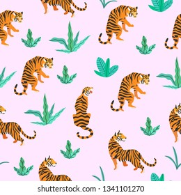 Vector illustration of tigers with tropical leaves on a pink background. Trendy seamless pattern.