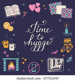 Vector illustration with Time to Hygge lettering and cozy home things like candles, socks, rug, tea, fireplace. Danish living concept. Greeting card template, hand drawn style.