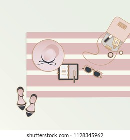 Vector illustration in top view perspective of feminine beach towel with women hat, notebook, heels and purse