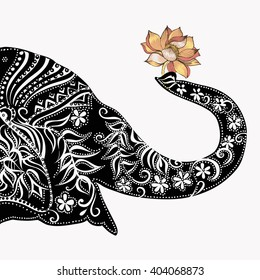 Vector illustration of a tribal totem animal - Elephant - in graphic style.  elephant head . Silhouette of an elephant with a flower . Indian elephant