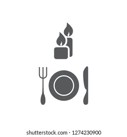 Vector illustration two candles, plate, fork and knife. Set of vector symbols. Table layout to a formal dinner party. A family dinner by candlelight. Flat design Monohrome