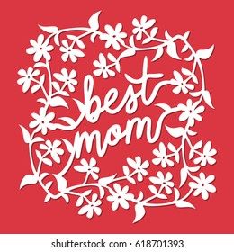 A vector illustration of vintage paper cut floral vines best mom phrase lace decoration. The lace is white and it is set against a red background.