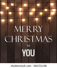 Vector illustration of wooden planks background with lighting garland festive decoration, with strings of round lamps and Merry Christmas to You inscription. Can be used for placard or poster design.