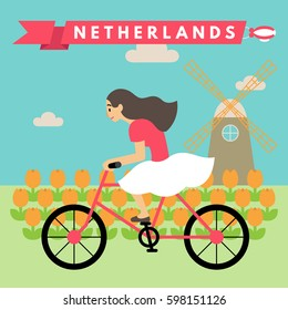 Vector illustration of young woman riding bicycle in tulip field and windmill in rural Netherlands, on sunny day with balloon sign saying Netherlands on sky. A promotional tourism concept image.